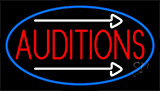Red Auditions With White Arrow Neon Sign